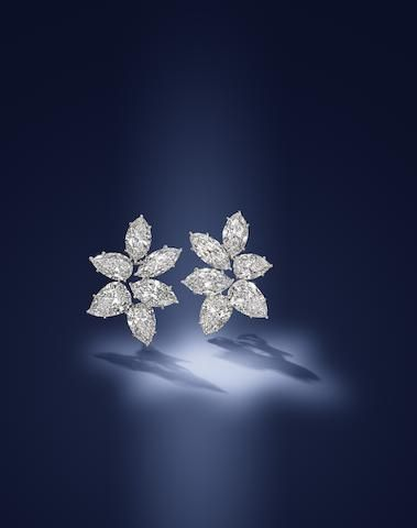 An exceptional pair of diamond earrings, by Harry Winston,