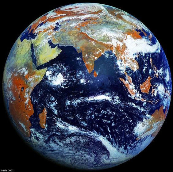 Earth is photographed with a high-definition 121megapixel camera - creating the sharpest image of our planet yet.....WOW,...LOOKS VERY NICE FROM AFAR....GREAT PIC:
