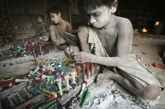 Bangladeshi child labourers work at a balloon workshop.  End child labour and let kids go to school.