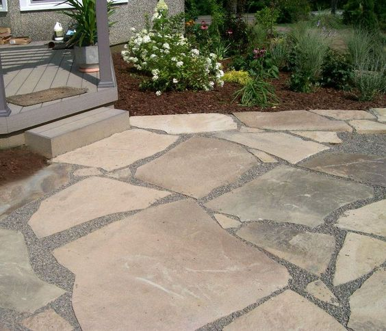 broken flagstone patio with crushed stone joints
