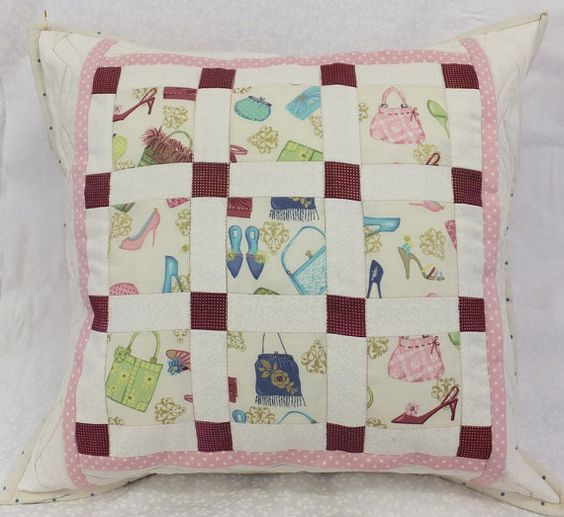 "Patchwork cushion. Handmade cushion with an 18"" pad.  Fabric featuring shoes and handbags ideal for the teenage bedroom."