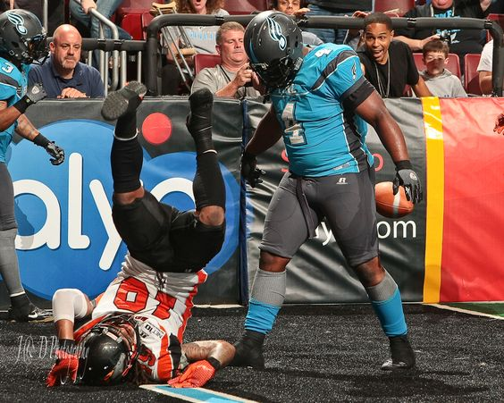 Philadelphia Soul FB Derrick Ross bowled over a Mustangs DB for a score. (Photo by Darryl Rule)