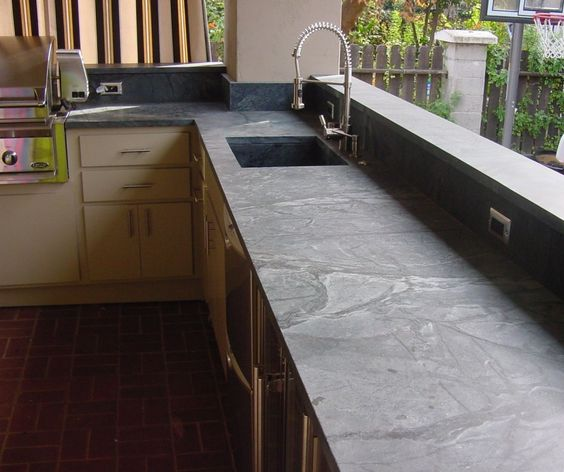 This soapstone has some really nice markings and the way it's designed as the backboard too you get a whole lot of this great look. You don't even need to look at the cabinets with this one.