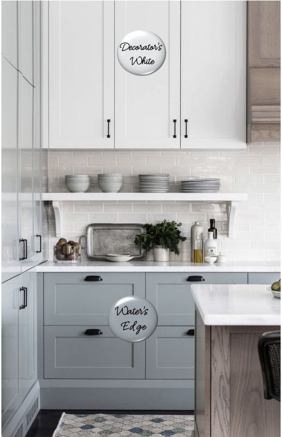 Two-toned painted cabinets in the kitchen are a hot trend that is here to stay! Here are some timeless paint color combos to consider for your kitchen to break up an all white kitchen. White and medium blue kitchen cabinets. #cabinetpaintcolors #paintcolorideas #kitchenpaintcolor #cabinetcolors #coloredcabinets #twotonedcabinets #porchdaydreamer #paintcombosa