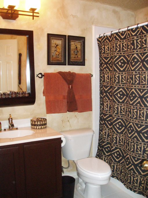 Bathroom Featuring African Tribal Art And Patterned Mudcloth Shower
