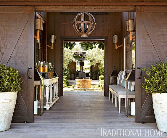 Walk through this entrance and you'll land directly in the open courtyard. - Photo: John Merkl / Design: Hillary Thomas: