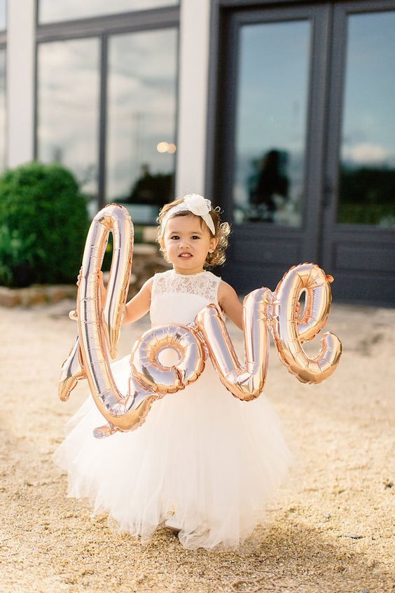 Ultra Romantic Stone Tower Winery Wedding by Julie Lim Weddings  - United With Love | Adorable Flower Girl with Giant Blush Love Balloon