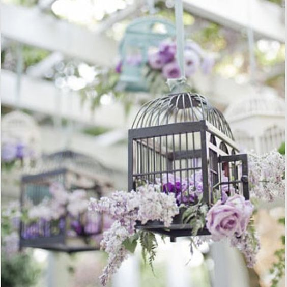 Lavender theme wedding, flower bird cage for hanging ornaments. Love or hate? #lavender #birdcage #wedding ornament