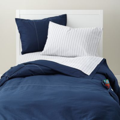 Cute bedding for new boys room. Simple with little pattern would match any theme. also love the pocket on the side.
