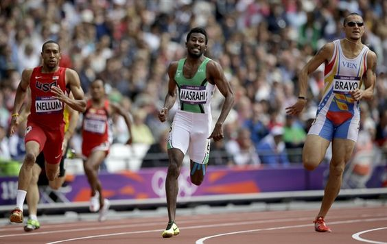 From left, United States' Bryshon Nellum, Saudi Arabia's Yousef Ahmed Masrahi, Venezuela's Albert Bravo compete in a men's 400-meter heat.