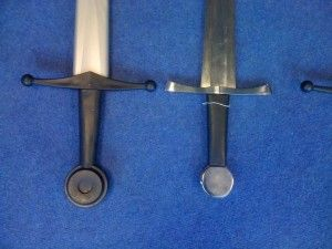 Rawlings next to Tinker Single Handed Sword (or Tinker Early Medieval Sword) available at SwordIndex.com