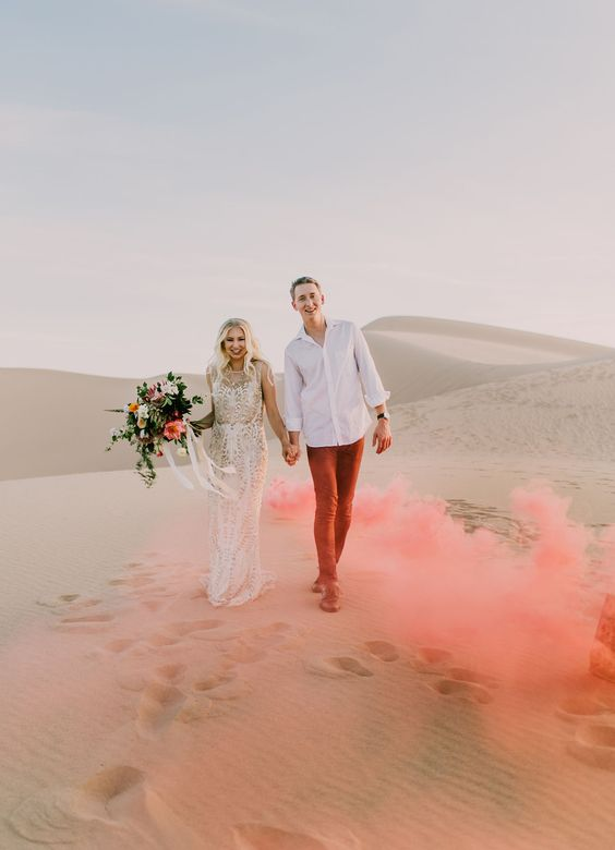 25 Jaw Dropping Spots That Will Make You Want to Elope | colored smokebomb elopement at the sand dunes: