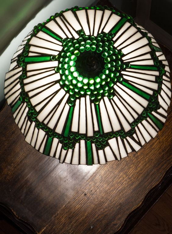 This lamp design is a variation on the original white 'Marbellous' lamp. It is smaller than the 50cm diameter original, at 38cm diameter, and the client requested just two tiers of glass 'shards' rather than three, along with green marbles and green shard highlights to complement the colour of her hallway. It is made using traditional copper foil technique.