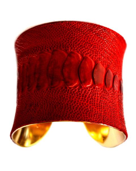 An UNEARTHED Signature Gold Lined Cuff bracelet, faced with 100% genuine ostrich leather which has been dyed an incredibly bold and dense blood red color! The leather has incredible texture and the scaling that runs the length of the cuff is completely natural and unaltered by us in any way.