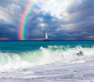 lonely boat against rainbow