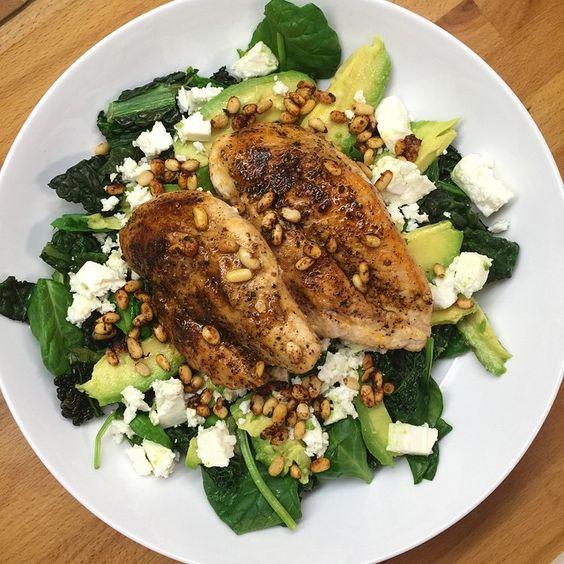 Chicken breast with kale, spinach, feta cheese, avocado & pine nuts all cooked in Coconut oil