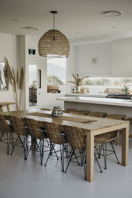 Tropical Kitchen With Sleek White Cabinets Rattan Dining Chairs