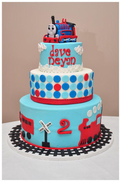Cake made for a customer, who provided some pictures to combine. I came up with this… :)