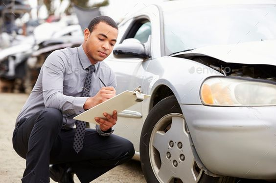 Loss Adjuster Inspecting Car Involved In Accident By