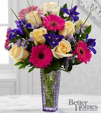 Hello Happiness Bouquet -- Roses and gerbera daisies are brilliant and bright, set to send happiness and cheer straight to the heart of your special recipient! Yellow roses, hot pink gerbera daisies, purple monte casino asters, purple iris and lush greens are brought together to form an eye-catching flower bouquet.