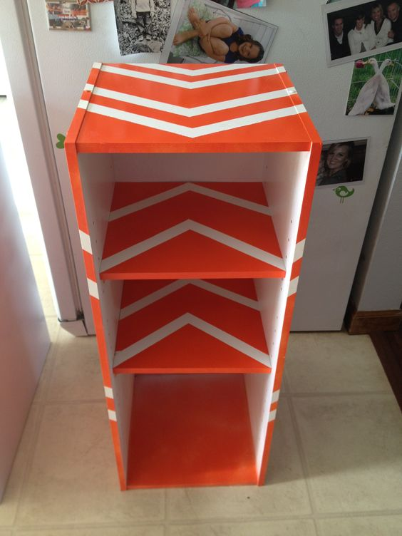 My Old pressed wood bookshelf redo. Taped off stripes then spray painted. Perfect for my little guys books now!