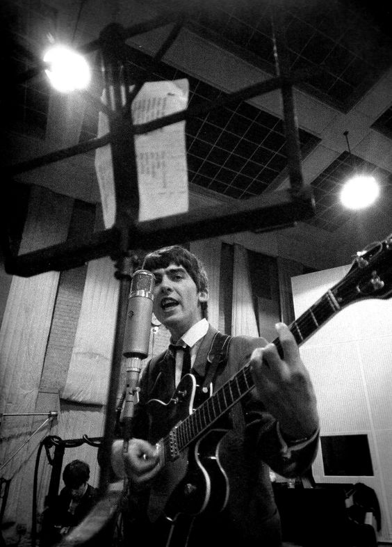 "thebeatlesordie: ""George Harrison with his Gretsch guitar, recording vocals, during recording sessions for 'Don't Bother Me'/With The Beatles at Abbey Road, 1963 """