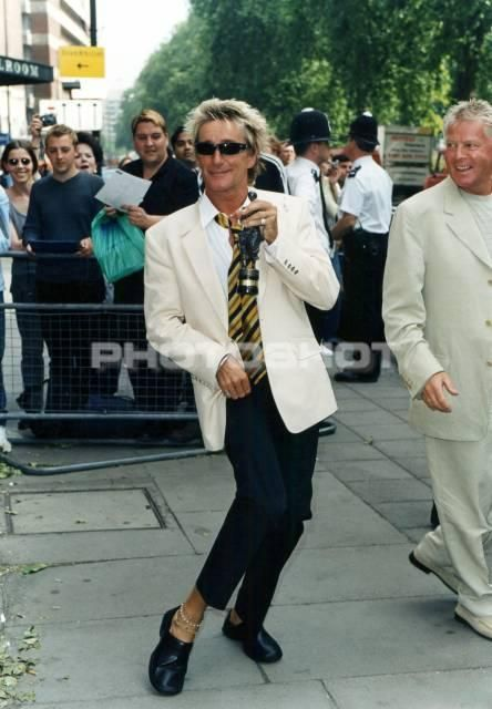 27th May 1999: Rod Stewart with his Ivor Novello Award in London.