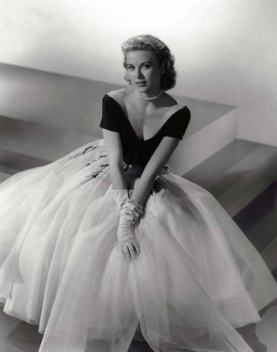 """Grace Kelly in an Edith Head Gown    """"A dress should be tight enough to show you're a woman and loose enough to prove you're a lady.""""   Edith Head"""
