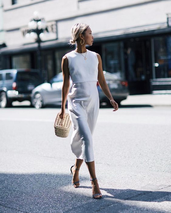'White is the symbol of purity, new beginnings, and...' More thoughts on my favorite color on www.thehautepursuit.com #TheOne @farfetch @dkny