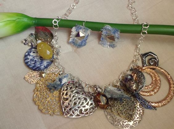 An Upcycled Jewelry Set Costumized For a Costumer using a picture she sent of a jean top..Made from vintage earrings, pendants and distressed jeans etc