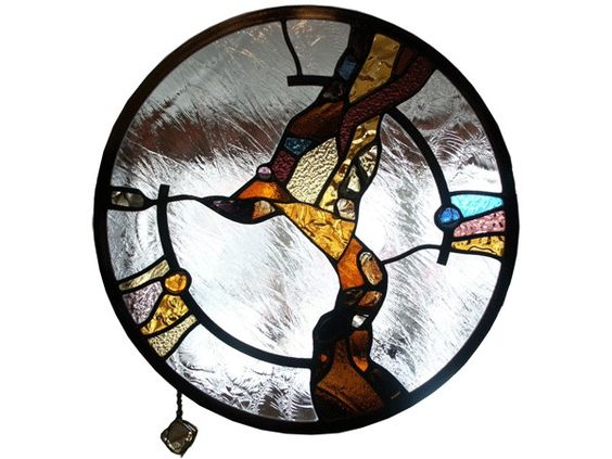 Stained and leaded glass round wall divider panel with slab glass peaces in amber tones