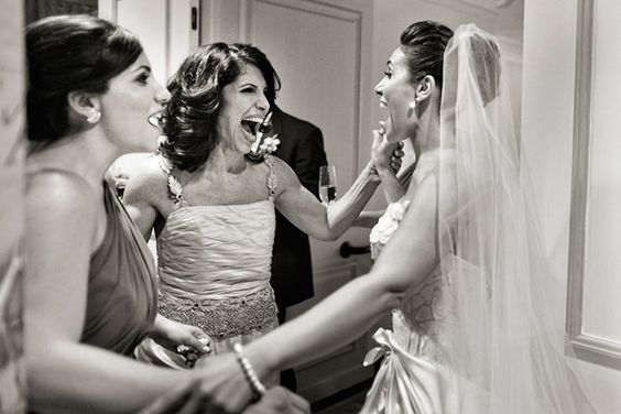 An ecstatic mother and daughter literally jump for joy that the big day has finally arrived!