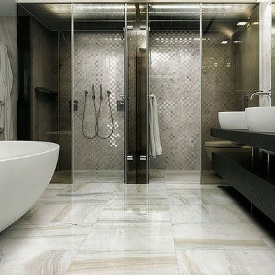 These large format porcelain tiles are designed to look - Marble look bathroom floor tiles ...