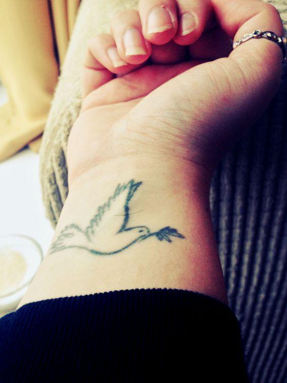 bird dove wrist tattoo small ring