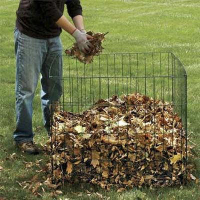 """To make fallen leaves easier to transport, rake them onto a plastic tarp. Roger adds them (along with leaves he's cleared from the gutters) to a compost bin—a simple chicken-wire pen will do. Flip the leaf pile every week with a garden fork to aerate; the """"black gold"""" that results next year can nourish lawns, flower beds, and shrub borders."""