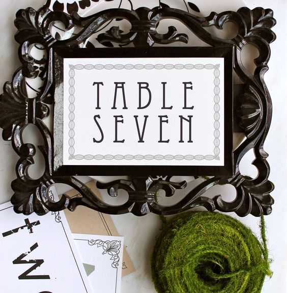incorporate vintage-inspired table numbers with an ornate frame by Beacon Lane