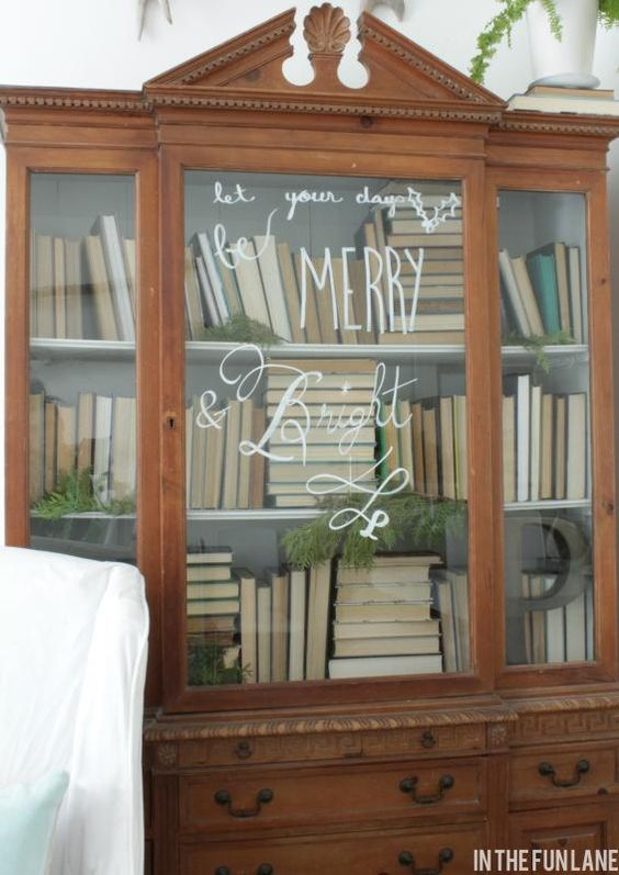 I picked up a glass felt pen at HomeDepot (it was $5, by Rustoleum) and did a little free hand message on the front of our bookcase.