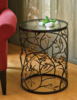 I have always liked these light airy, iron sculpted wire tables.  I can imagine these in silver too ...