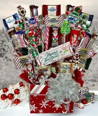Winter Wonderland Candy BouquetThis festive Christmas candy bouquet is filled with a wide variety of holiday candy: Ghirardelli holiday squares in peppermint bark, spiced cinnamon and eggnog; Ghirardelli milk, dark and mint chocolate squares; Hershey's Santas, York peppermint snowflakes and Reese's peanut butter trees; old-fashioned candy sticks and a candy Christmas tree; plus lots of everyone's favorite candy bars.