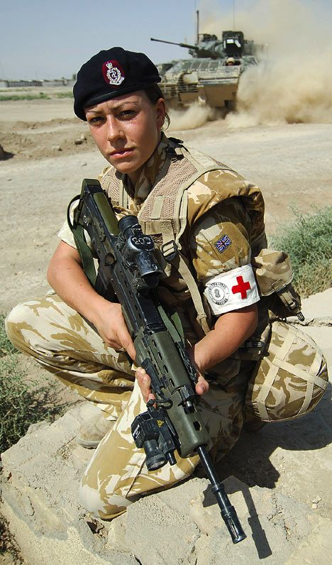 A teenage army medic has become the first woman to be awarded the Military Cross, one of the highest honours for gallantry in combat.  Private Michelle Norris, 19, braved a hail of sniper and machine-gun fire from 200 insurgents during a pitched battle in  southern Iraq in order to give lifesaving treatment to a wounded comrade.