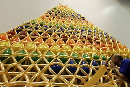 Canadian artist Sean Rooney works on his 6-metre-tall pyramid sculpture made out of rainbow-coloured balloons for the annual Kids Fest in Sarajevo June 12, 2007.