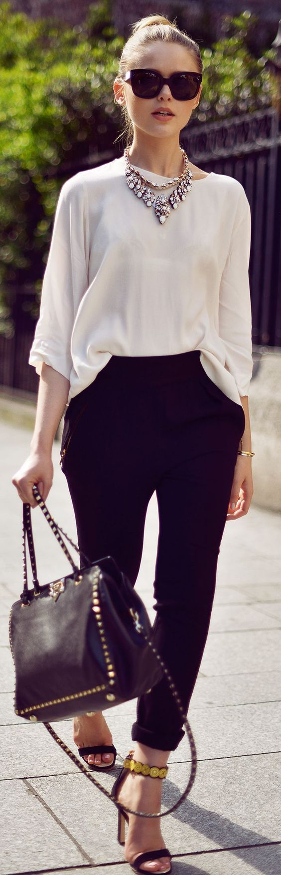 Chic office style with over-sized sunnies, statement necklace, and perfect black trousers.