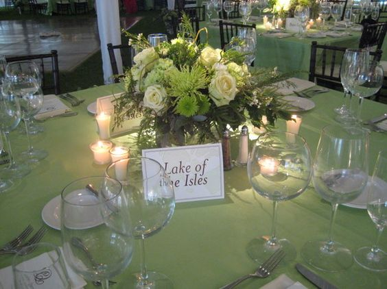 The centerpieces for the dinner reception were made of supergreen roses, green carnations, mums, ferns, curly willow, and wax flower. As a finishing touch the tables were named after lakes in the region.