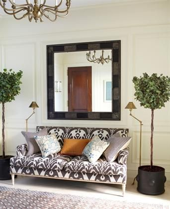 patterned settee, oversized mirror, and potted trees | Tim Whealon