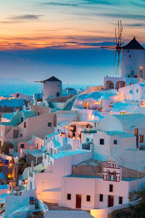 The hillside town of Oia is one of the most famous and photographic towns in Santorini, a small group of islands in the Aegean Sea #Greece #Santorini