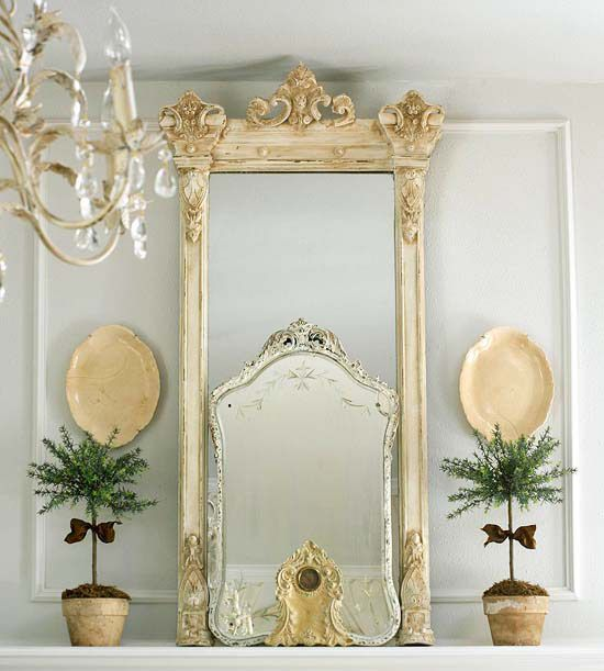Slightly overlapped or placed against one another, large mirrors will practically double the natural light in the room. Add another piece in front of the mirrors, with a similar tone and an interesting shape, to create depth.