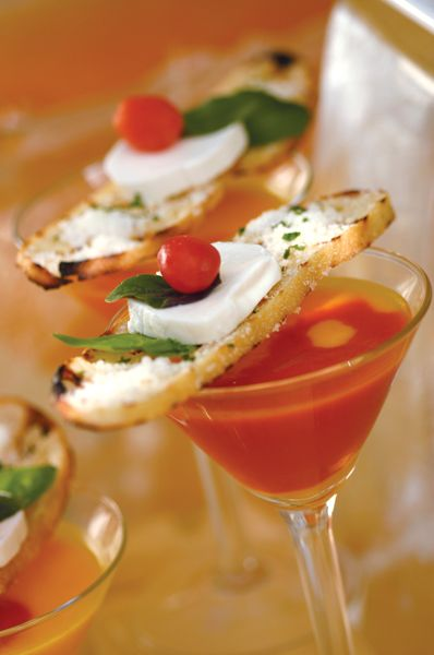 The grilled cheese and tomato soup is delightful. Served chilled in a martini glass, the two-toned vine ripened tomato soup is topped with a fresh mozzarella and basil crostini sandwich.  #fingerfood #shopfesta