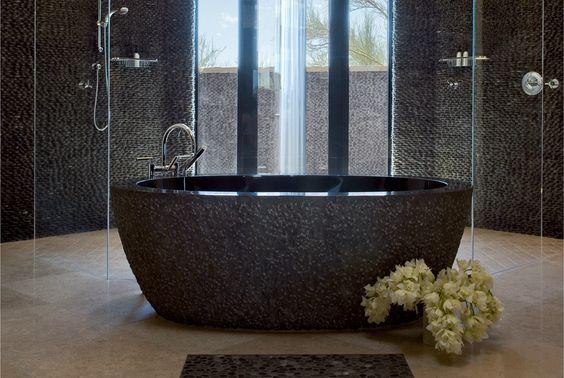 Island stone usa modern bathroom with black granite for Limestone tub