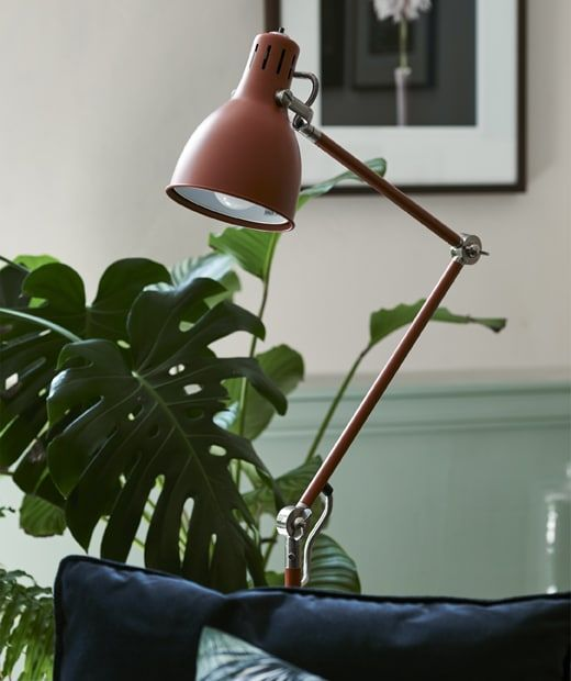 A Red Brown Floor Lamp In A Room With Plants Brown Floor Lamps