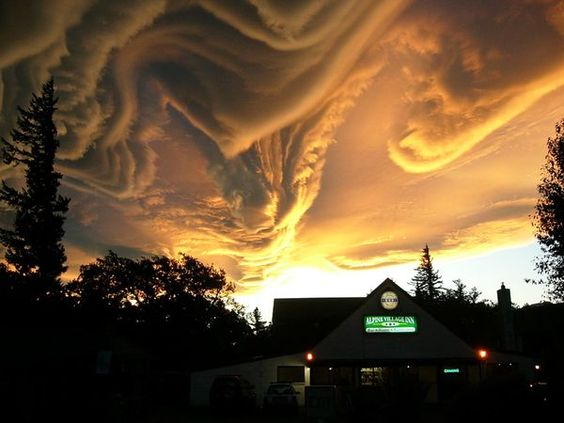 Wicked Weather in New Zealand - The clouds look like a dragon!